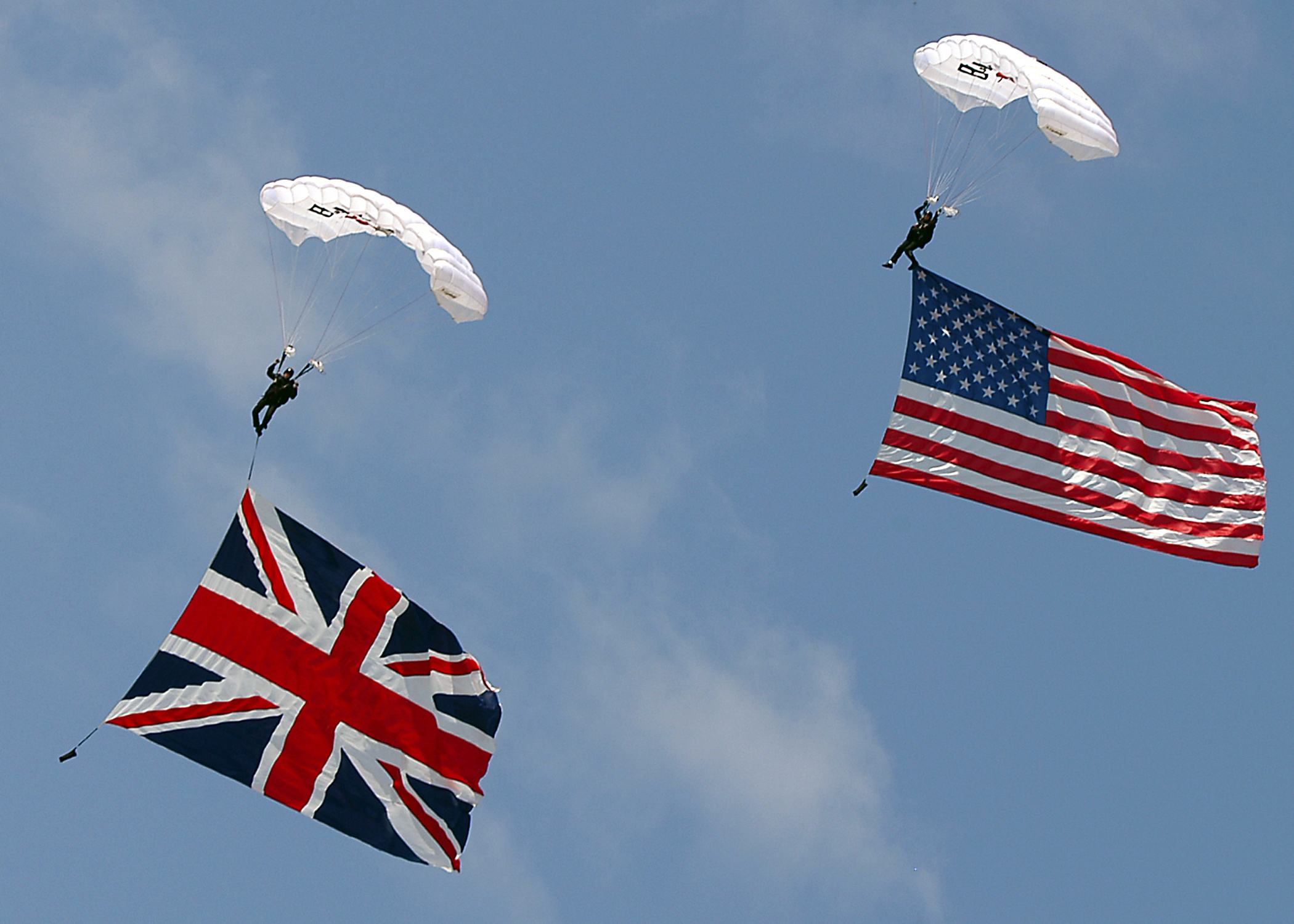 070908-N-1082Z-029 VIRGINIA BEACH, Va. (Sept. 8, 2007) - Members of the Blackwater USA parachute team wave Old Glory and the Union Jack during their demonstration at the 2007 Naval Air Station Oceana Air Show. The show featured a variety of civilian and military aircraft flight demonstrations and static displays. U.S. Navy photo by Mass Communication Specialist 2nd Class Jason R. Zalasky (RELEASED)